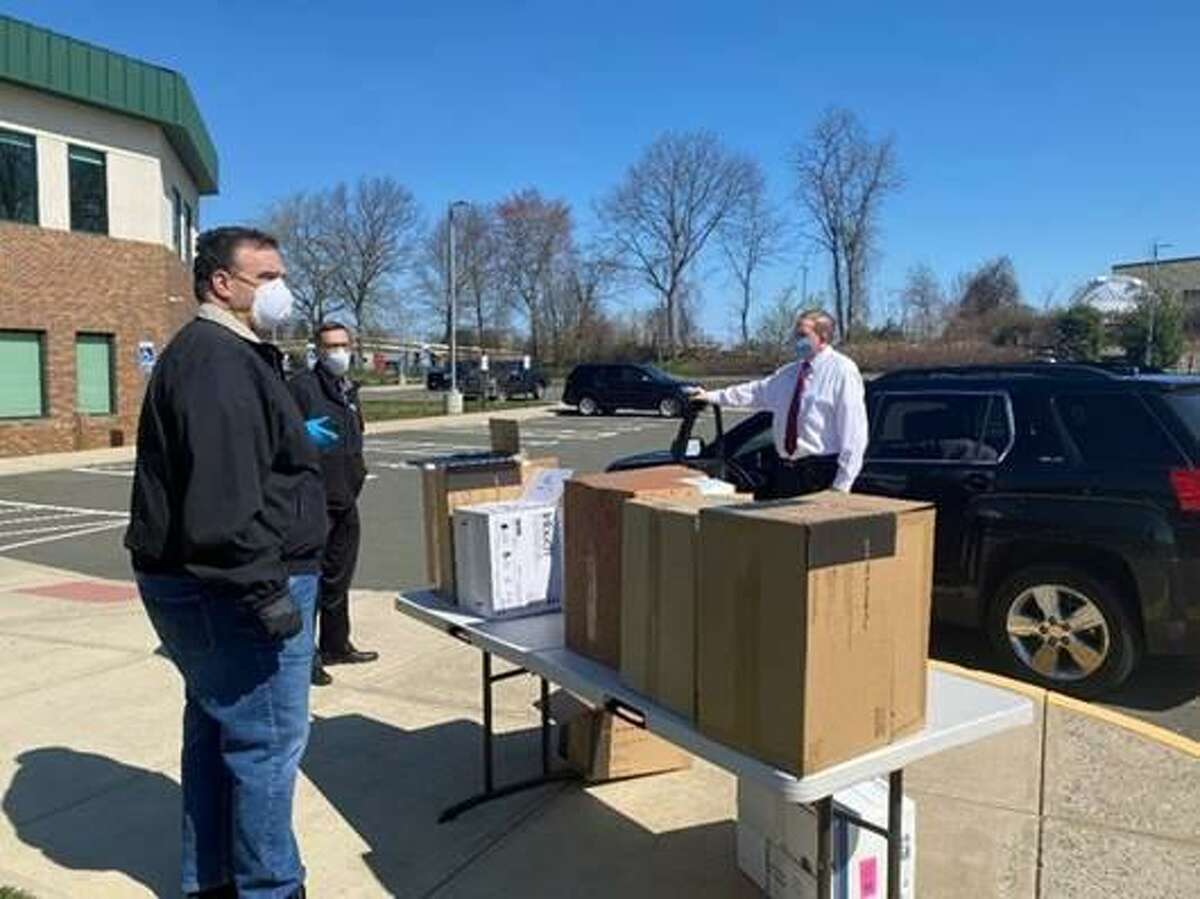 An effort to distribute personal protective equipment and cleaning supplies to state housing in southwestern Connecticut came to Cheshire Wednesday, according to a release from the HAI Group. Here, from left: Ed Malaspina, chief executive officer at HAI Group; Scott Bertrand, executive director at the Enfield Housing Authority; and Edward Ramsdell, chief executive officer at Orion Protective Services Inc. for The Marvin in Norwalk.