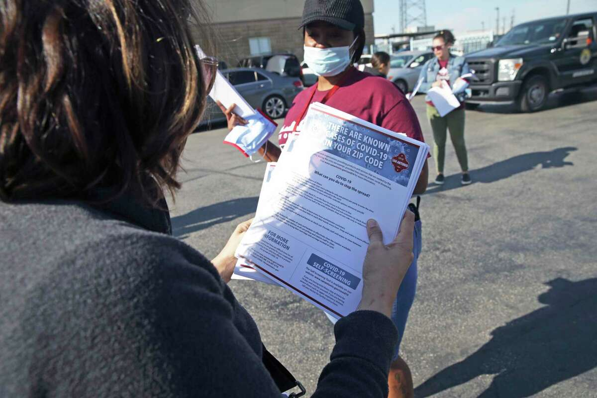 Flyers warning of contagion dangers are readied as Metro Health's Community Health and Prevention team sets out to deliver COVID-19 information to local businesses this week.