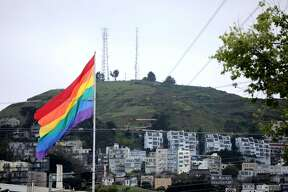 A massive rainbow flags hangs on a flagpole in The Castro on Saturday, April 11, 2020, in San Francisco, Calif.