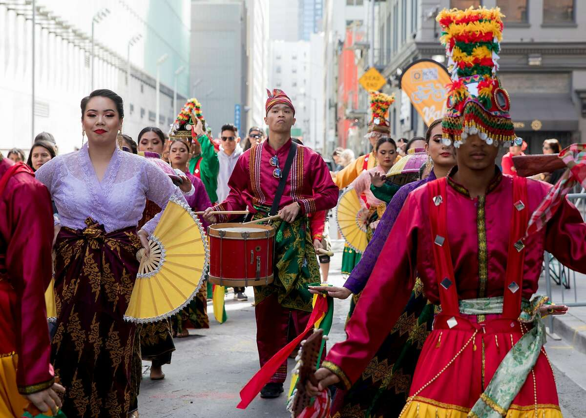 Traditional Filipino indigenous cultural dancers perform during Undiscovered SF's creative night market in San Francisco, Calif. Saturday, July 20, 2019.