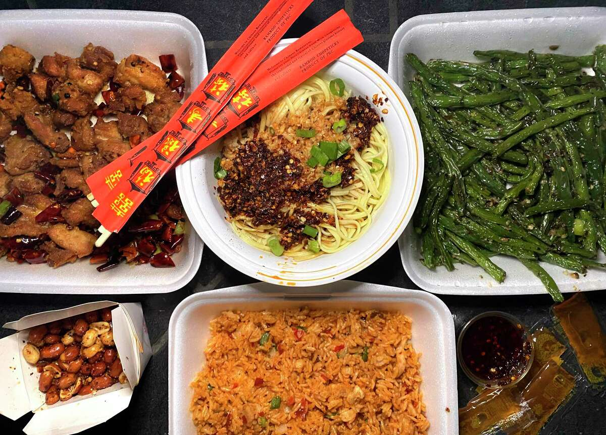 Sichuan House takeout options include, clockwise from top left, crispy spicy chicken, garlicky cold noodles, green beans, Sichuan fried rice with pork and spicy-sweet peanuts.