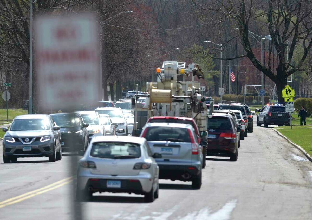 Distributors ran out of food to give to families at Rogers Park Middle School within roughly 20 minutes on Thursday morning. Cars backed up out of the park and onto South Street, Mountainville Avenue and part of Main Street. Thursday, April 16, 2020, in Danbury, Conn.
