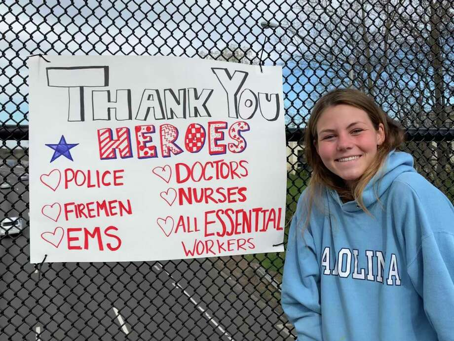 In April, Sophie Pullen was one of the members of The Depot's Girls Night Out club who helped to create and place thank-you posters around town for Darien's medical staff and first responders. Photo: Depot /