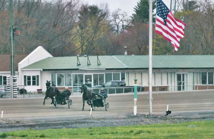 Drivers run horses around the track during a workout at the Saratoga Harness Track on Thursday, April 16, 2020, in Saratoga Springs, N.Y. (Paul Buckowski/Times Union)