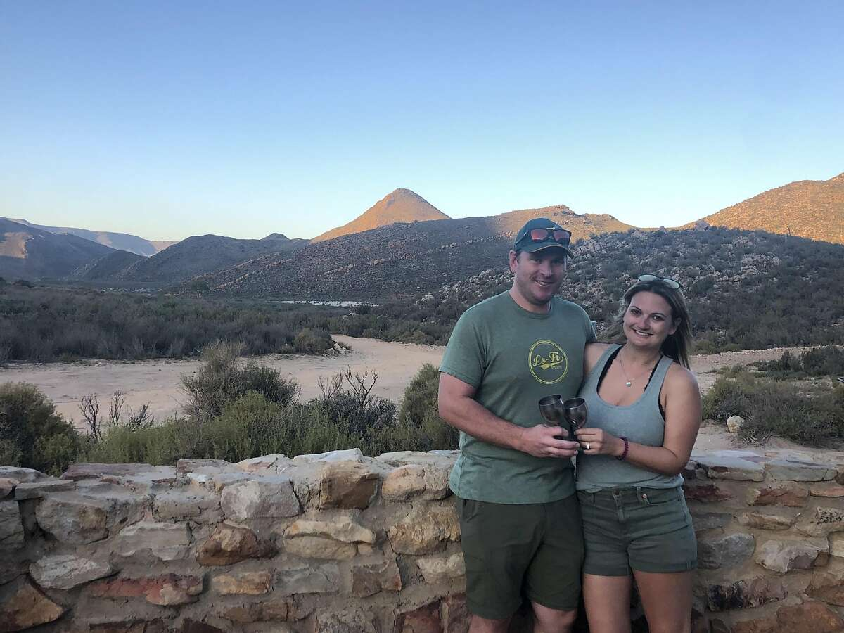The author Jess Lander, with her husband Rick Reinell at Aquila Game Reserve in South Africa.