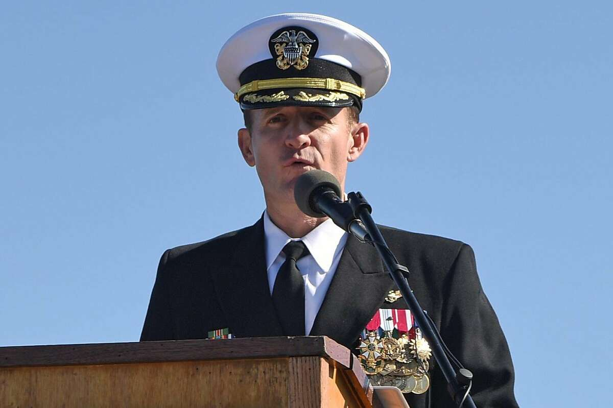 FILE -- Capt. Brett E. Crozier addressing the crew during a change-of-command ceremony on the flight deck of the aircraft carrier Theodore Roosevelt in San Diego, Nov. 1, 2019.