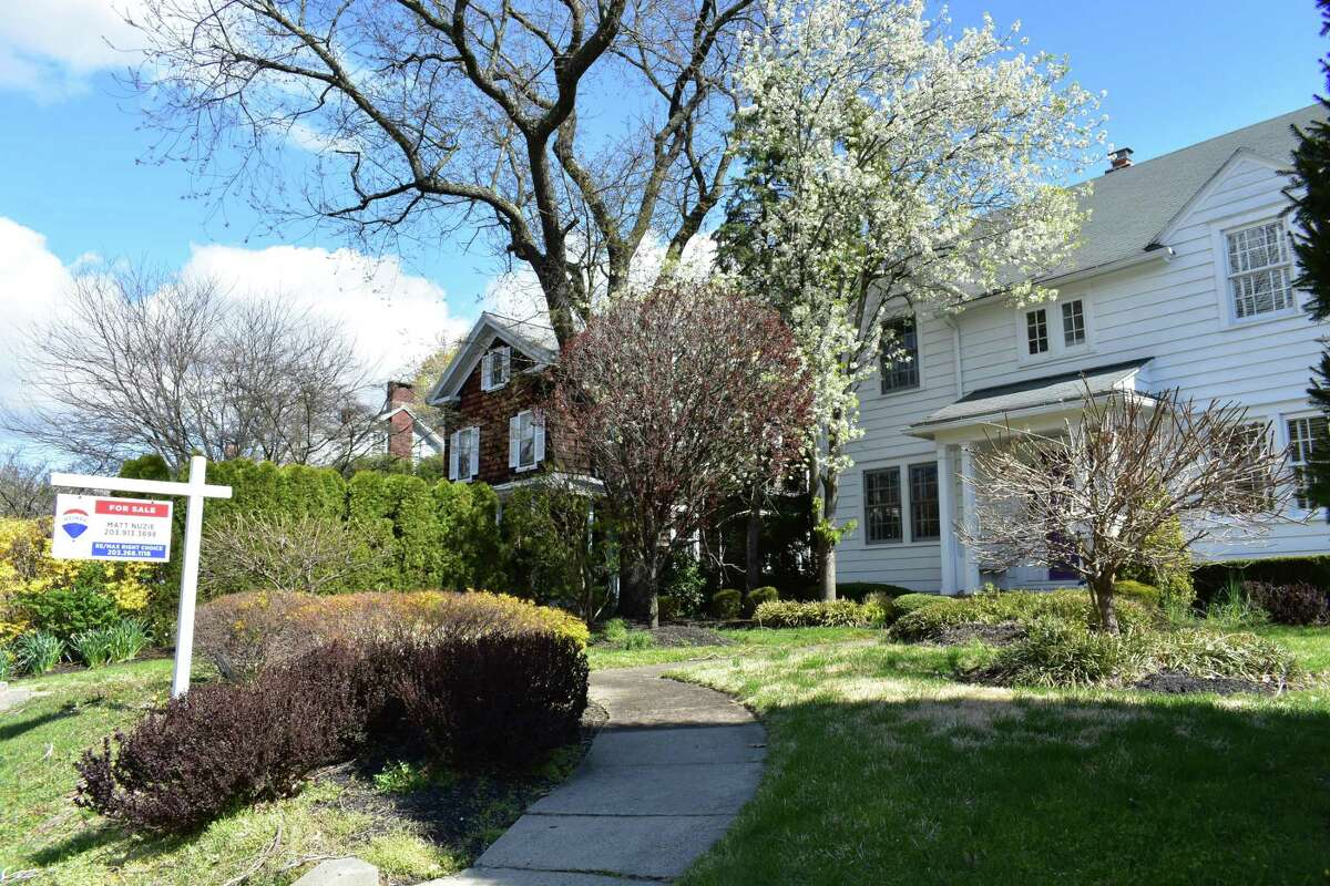 Stratfield Road homes in Fairfield, Conn., with one listed for sale (right) as of mid-April and the other next door sold on the last day of March, contributing to a 5.6 percent increase in Connecticut sales statewide compared to the first quarter of 2019.