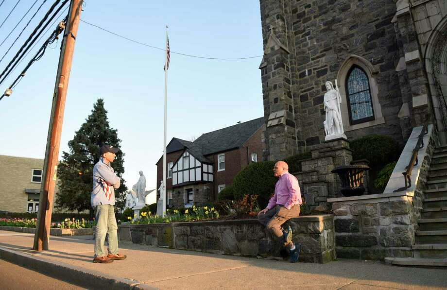 """First Selectman Fred Camillo, left, chats with church trustee Paul Cappiali before the church bells chime at St. Roch Church in the Chickahominy section of Greenwich, Conn. Wednesday, April 15, 2020. St. Roch is one of the Greenwich churches that has chimed to thank healthcare workers and first responders for their commitment and unite the community. On Wednesday, the church bells played """"God Bless America"""" complete with a live stream on their website. Photo: Tyler Sizemore / Hearst Connecticut Media / Greenwich Time"""
