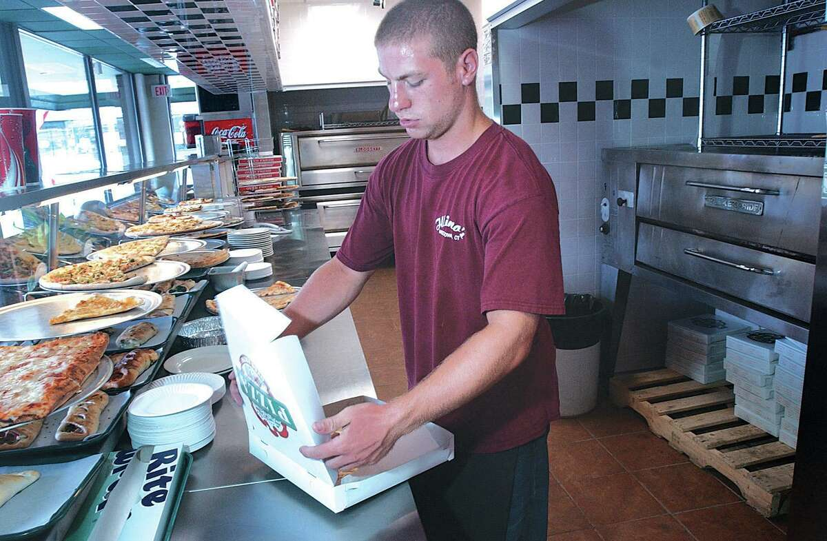 An Illiano's Ristorante and Pizzeria employee prepares an order at the Washington Street location in Middletown. This photograph was taken in August 2004, a week after the eatery opened.