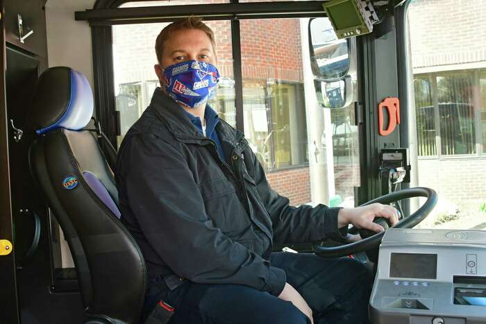 "Bus driver Josh Richards is seen in the drivers seat as CDTA staff participate in the ?'Sound the Horn?"" tribute for transportation workers across the country at CDTA headquarters on Thursday, April 16, 2020 in Albany, N.Y. Transportation workers are providing critical service for healthcare workers, first responders, childcare workers, grocery store employees and others who are performing critically, essential work during the Covid-19 pandemic. (Lori Van Buren/Times Union)"
