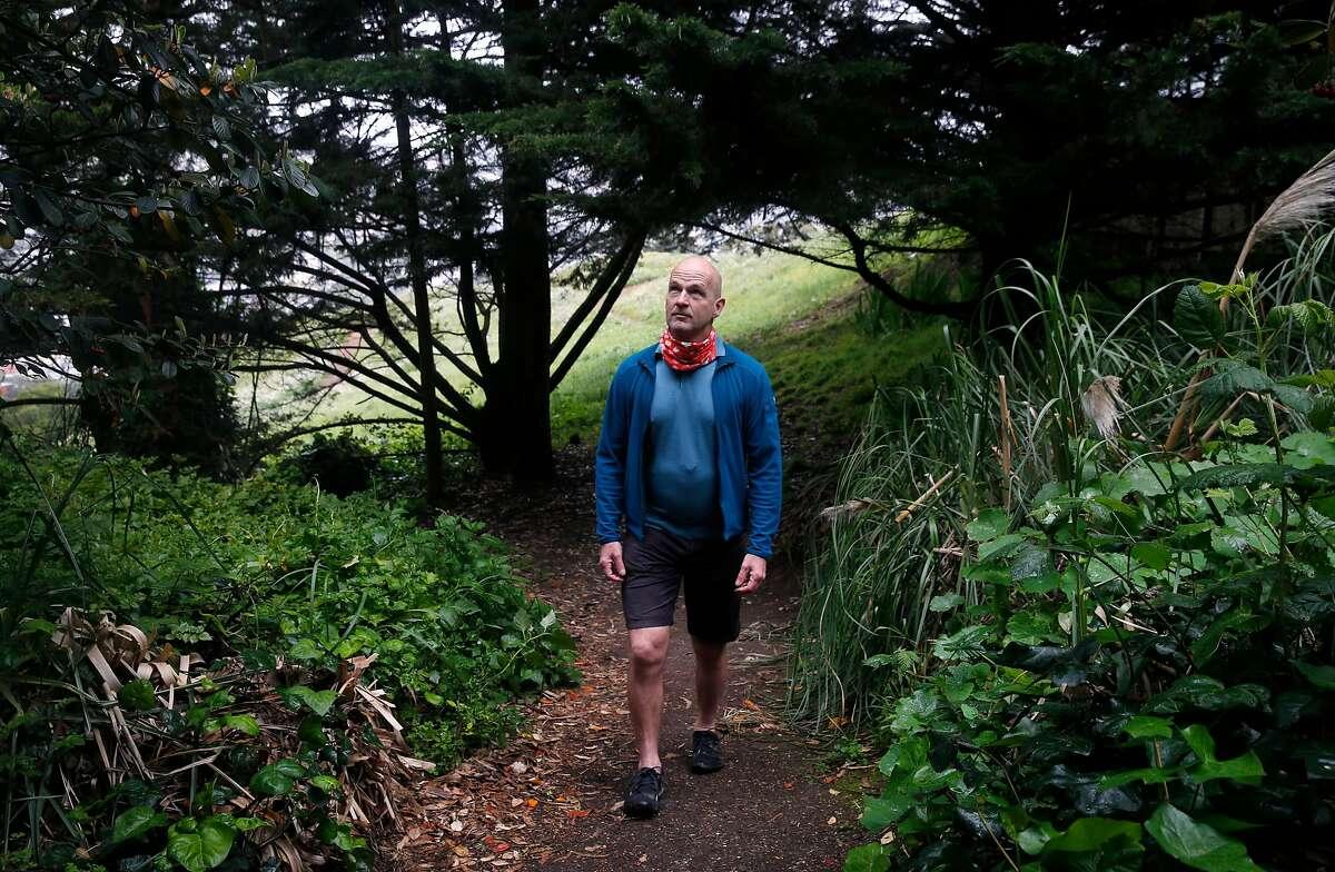 Shundo David Haye walks in solitude on the trails of Kite Hill during the coronavirus pandemic in San Francisco, Calif. on Thursday, April 16, 2020.