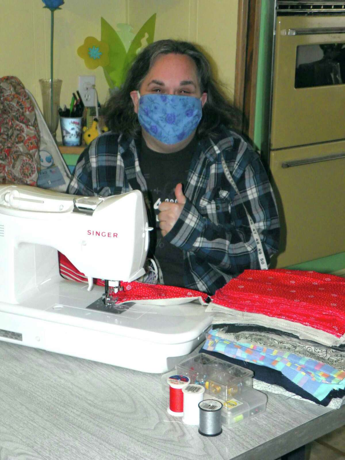 Laura(pictured), works with her sister, Linda Marshall, to make hand sewn face masks. They have made more than 300 masks, which are free to anyone who requests them. (Submitted photo)
