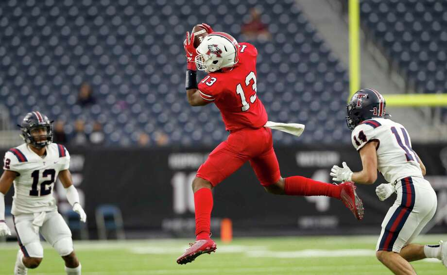 Atascocita Eagles Landen King (13) catches a pass defended by Tompkins Falcons Colby Huerter (14) during the first half of the high school football playoff game between the Tompkins Falcons and the Atascocita Eagles at NRG Stadium in Houston, TX on Saturday, November 30, 2019. The Eagles lead the Falcons 35-3 at halftime. Photo: Tim Warner, Houston Chronicle / Contributor / ©Houston Chronicle