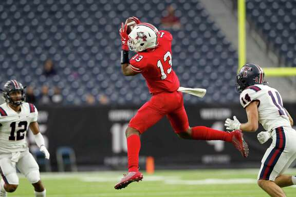 Atascocita Eagles Landen King (13) catches a pass defended by Tompkins Falcons Colby Huerter (14) during the first half of the high school football playoff game between the Tompkins Falcons and the Atascocita Eagles at NRG Stadium in Houston, TX on Saturday, November 30, 2019. The Eagles lead the Falcons 35-3 at halftime.
