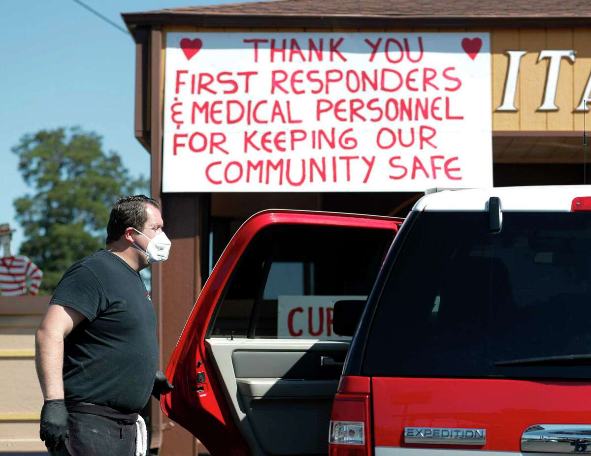Joe Haliti, owner of Joe's Italian Restaurant, helps bring out lunch for members of the Conroe Fire Department, Wednesday, April 15, 2020, in Conroe. Haliti and his staff served more than 240 meals to Montgomery County first responders Wednesday as part of his rotating list of 50 departments and services he provides meals for each week.
