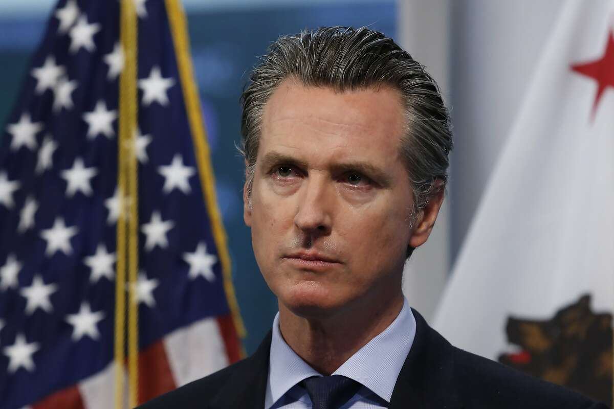 California Gov. Gavin Newsom listens to a reporter's question during his daily news briefing at the Governor's Office of Emergency Services in Rancho Cordova, Calif. Thursday, April 9, 2020. Newsom announced that California saw its first daily decrease in intensive care hospitalizations during the coronavirus outbreak, a key indicator of how many health care workers and medical supplies are needed. He went on to say the state's hospitals have thousands of ventilators available should the number of the sickest patients suddenly surge. (AP Photo/Rich Pedroncelli, Pool)