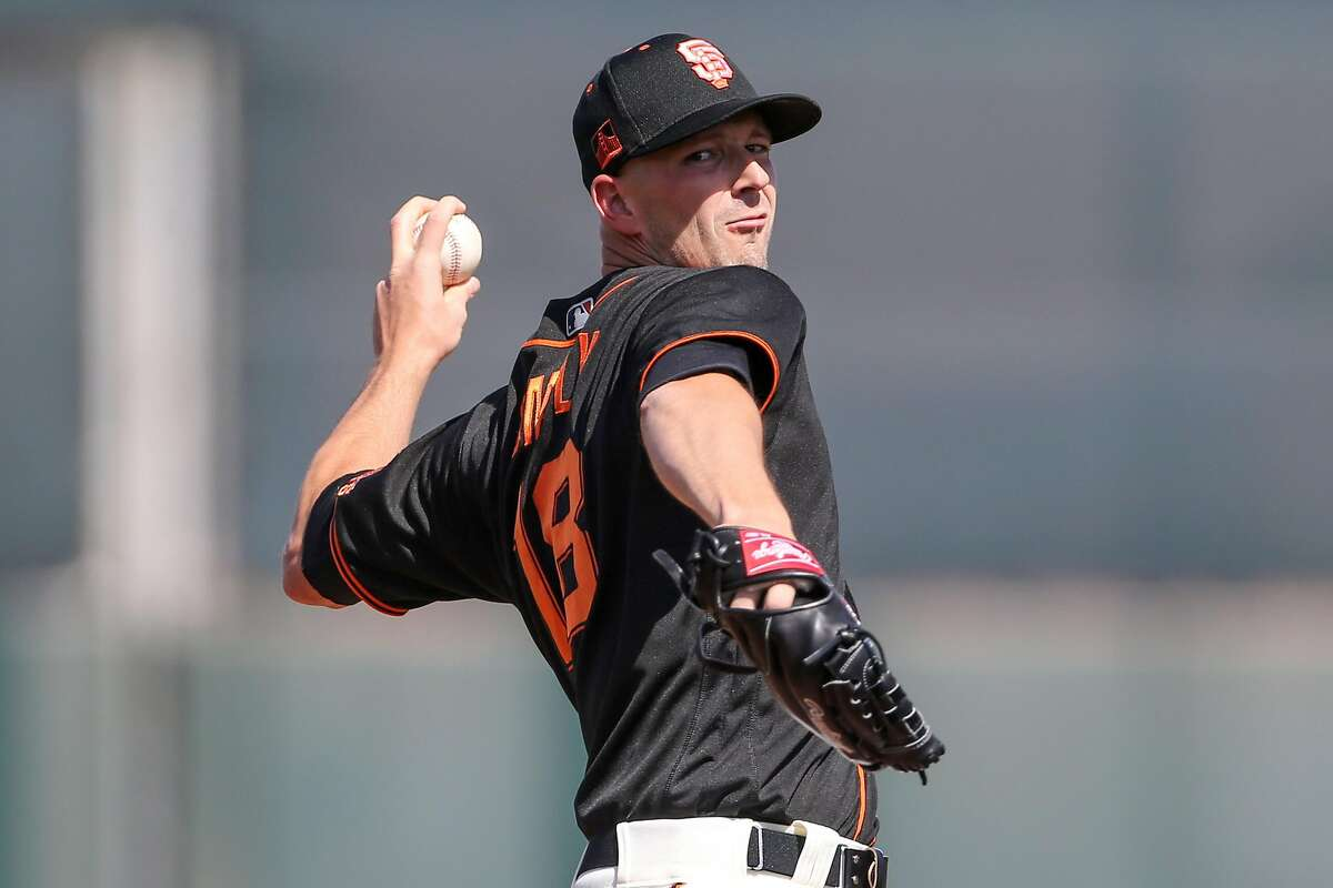 San Francisco Giants pitcher Drew Smyly delivers a pitch during their game with the Cleveland Indians at Scottsdale Stadium Thursday, March 5, 2020, in Scottsdale, Arizona.