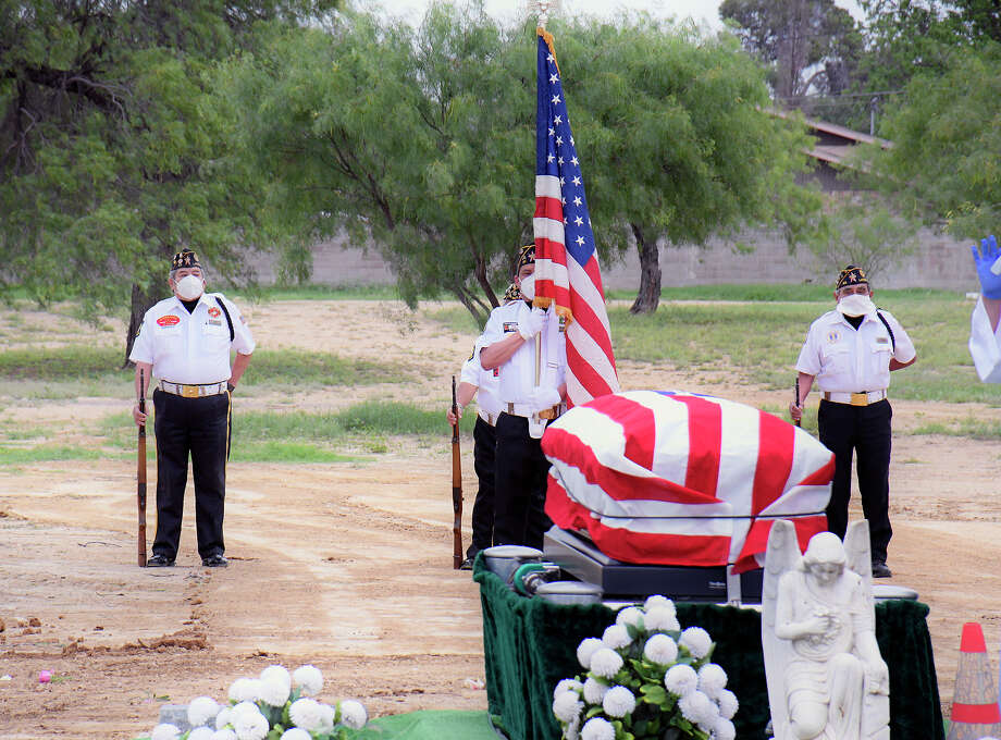 Following CDC guidelines for the Coronavirus members of the American Legion Post 59 Honor Guard must keep their distance from funeral ceremonies for military veterans as they did in a service at the City of Laredo Cemetery, Tuesday, April 14, 2020. Photo: Cuate Santos/Laredo Morning Times