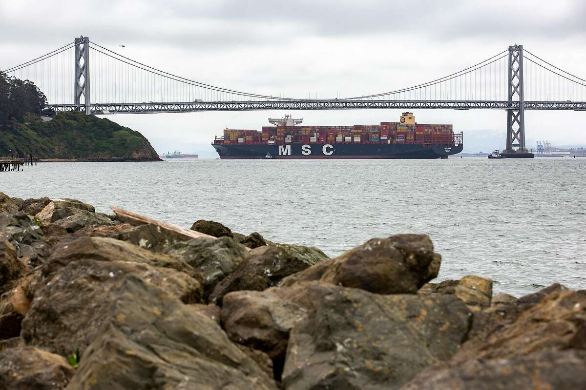 The MSC Anna arrives to the San Francisco Bay as it makes its way underneath the Bay Bridge towards the Port of Oakland on Thursday, April 16, 2020.