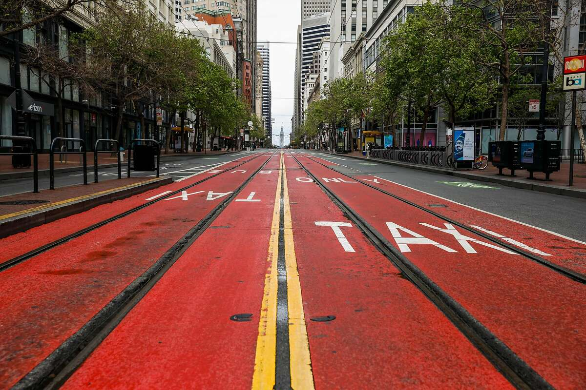 An empty Market Street during the second week of shelter in place orders due to the coronavirus on Sunday, March 29, 2020 in San Francisco, California. Starting Monday, there will be no more subway or light rail service in San Francisco.