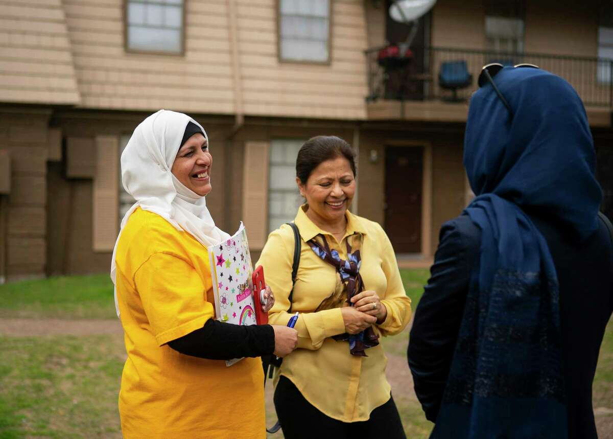 Halah Abboodm and Aisha Siddiqui, the founding director of Culture of Health-Advancing Together (CHAT), talk to one of Abboodm's neighbors about the coming 2020 Census, Monday, March 2, 2020, at the Ashford Crescent Oaks apartments in Houston's Gulfton neighborhood. Abboodm, a new U.S. citizen who is originally from Iraq, has been working to get community members to sign a pledge card that they will fill out the 2020 Census.