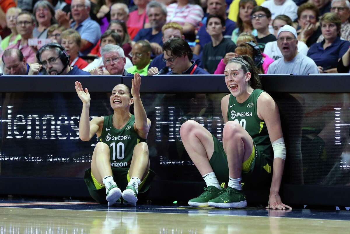 UNCASVILLE, CT - JULY 20: Seattle Storm guard Sue Bird (10) and Seattle Storm forward Breanna Stewart (30) cheer on their team as they wait to enter the game during a WNBA game between Seattle Storm and Connecticut Sun on July 20, 2018, at Mohegan Sun Arena in Uncasville, CT. Seattle defeated Connecticut 78-65. (Photo by M. Anthony Nesmith/Icon Sportswire via Getty Images)
