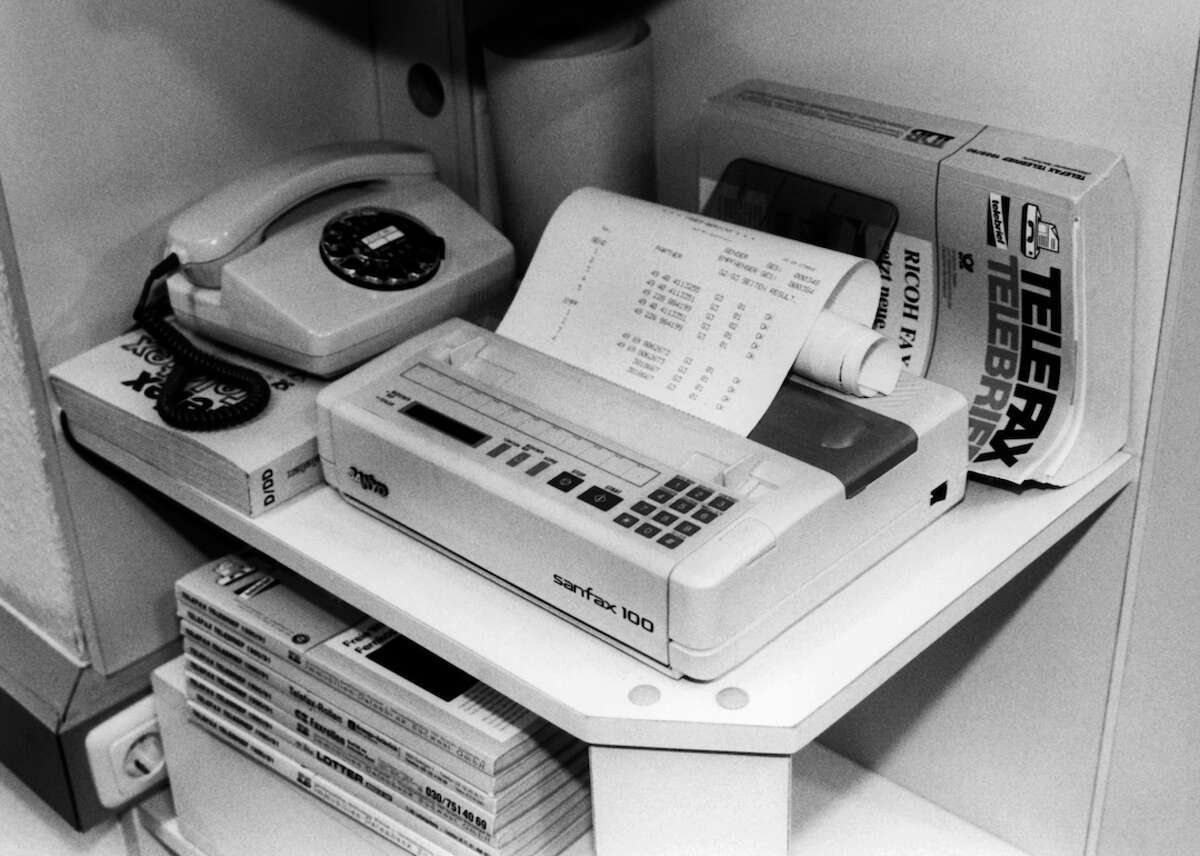 The fax machine started hitting offices in the mid-1970s. Networks of fax machines allowed workers to send information to each other faster than ever before, potentially helping to boost productivity.