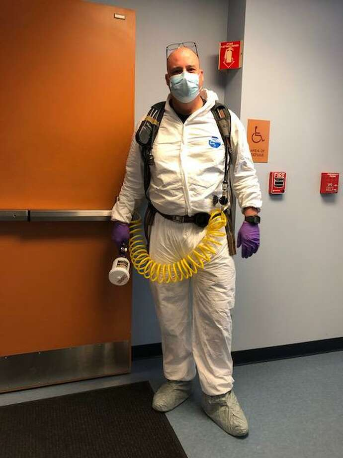 Fire Lt. William McKnight prepares to decontaminate a building in Cromwell. Photo: Contributed Photo