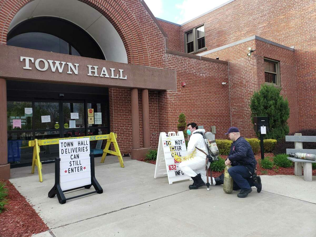 The entrance to Cromwell Town Hall is disinfected earlier this year.