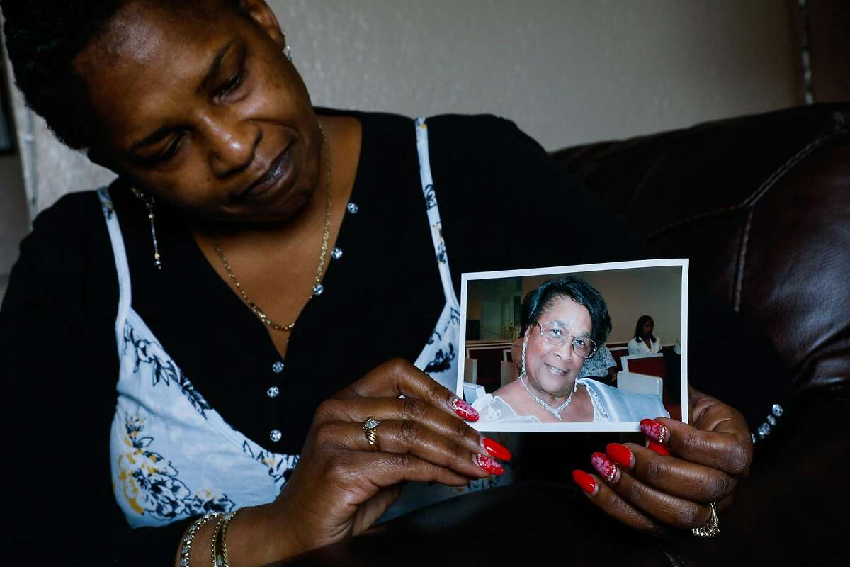 Natalie Henry Berry shows a photo of her mother Tessie Henry who died of Covid-19 at the age of 83 in her home on Saturday, April 11, 2020 in San Francisco, California.