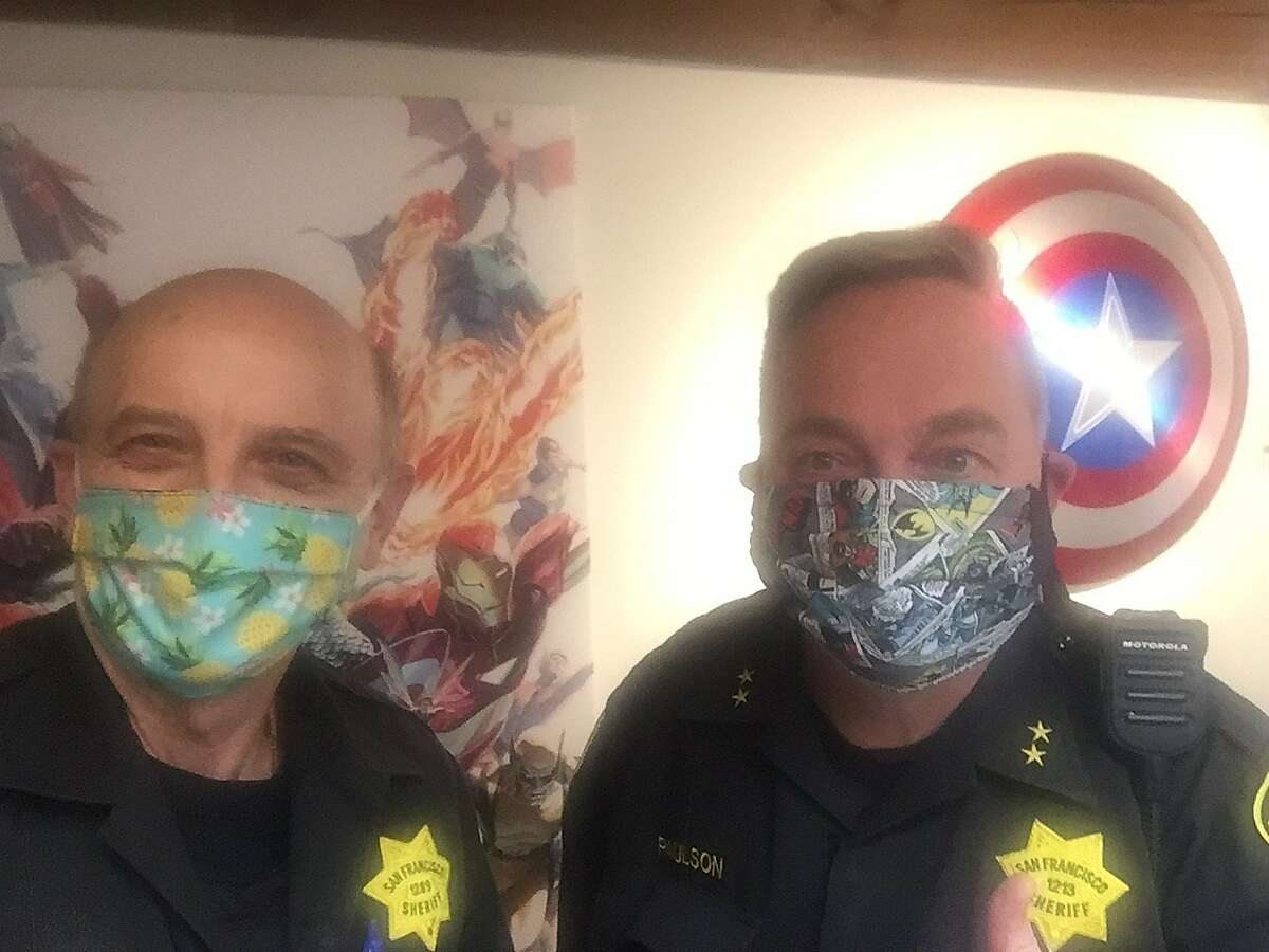 """""""Crazy Mike"""" (left) and Kevin Fisher-Paulson (right) show off their face masks."""