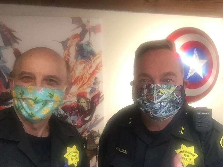 """Crazy Mike"" (left) and Kevin Fisher-Paulson (right) show off their face masks. Photo: Courtesy Kevin Fisher-Paulson"