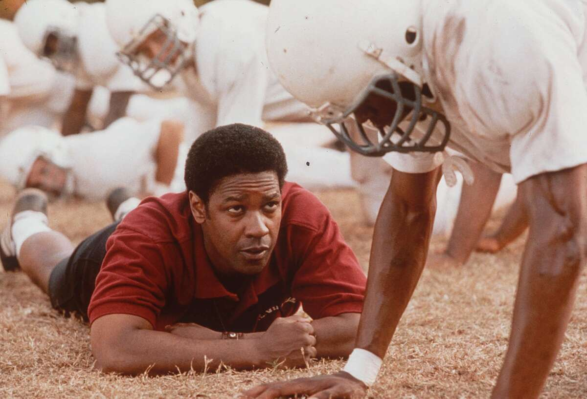 REMEMBER THE TITANS - Denzel Washington, as coach Herman Boone, in a scene from the drama ``Remember the Titans,'' from Walt Disney Pictures/Jerry Bruckheimer Films. (AP Photo/Tracy Bennett for Walt Disney Pictures. HOUCHRON CAPTION (08/31/2000):