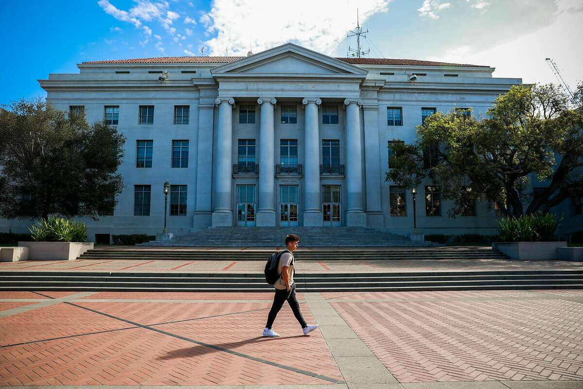 A man walks past Sproul Hall on the UC Berkeley campus a day after Berkeley suspended in-person classes due to the coronavirus.