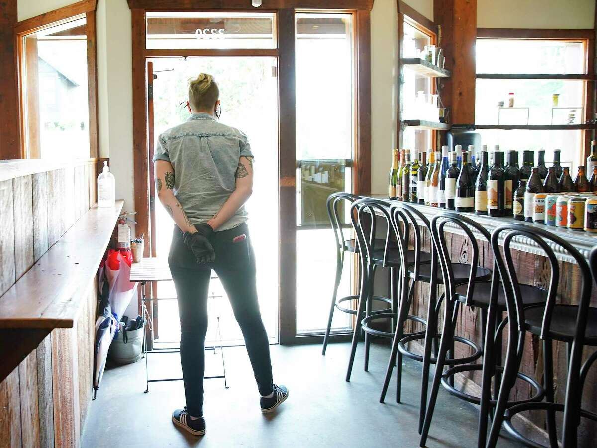 Kira Black, a server at Coltivare, waits to take a take out order to the curb at the popular Heights neighborhood restaurant in Houston on Thursday, April 16, 2020.