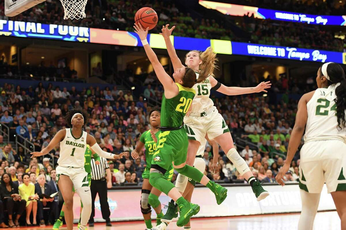 Baylor forward Lauren Cox (15) is projected as a top five selection in Friday's WNBA draft, while Sabrina Ionescu (20) of Oregon is projected as the top pick.