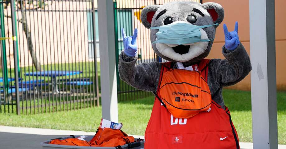 Houston Rockets mascot Clutch helps give activity packets to families at Spring Branch Boys & Girls Club on Thursday. Photo: Houston Rockets
