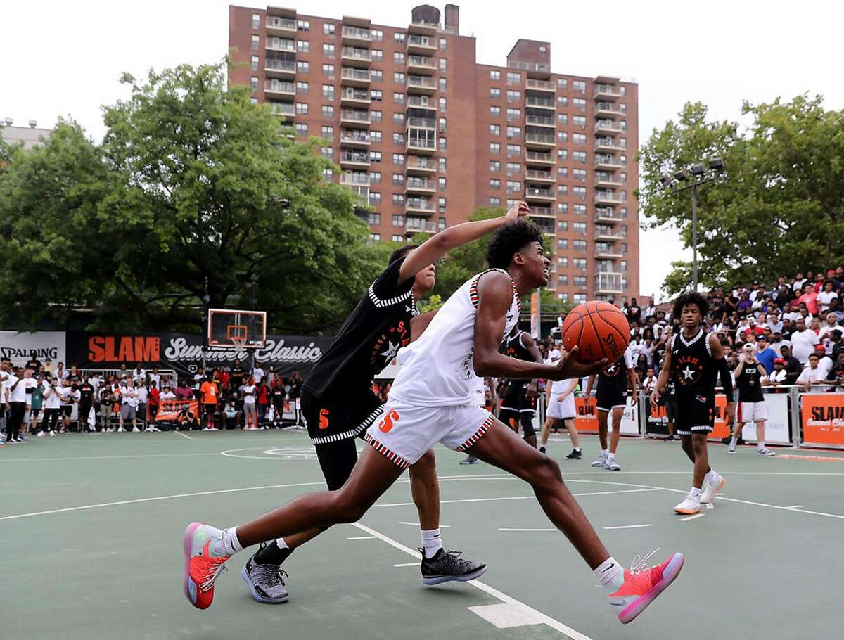 Jalen Green #4 of Team Stanley heads for the net as RJ Hampton #5 of Team Ramsey defends during the SLAM Summer Classic 2018 at Dyckman Park on Aug. 18, 2018 in New York City. (Photo by Elsa/Getty Images/TNS)