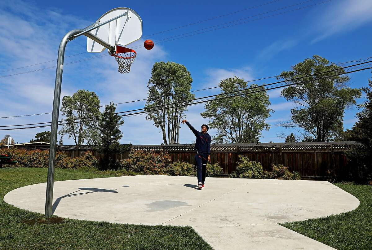 """High School basketball star Jalen Green, 18, shoots a basket in his neighborhood on Friday, March 27, 2020, in Napa, Calif. The 6'6"""" guard is expected to be the No. 1 men's basketball recruit in the 2020 class."""