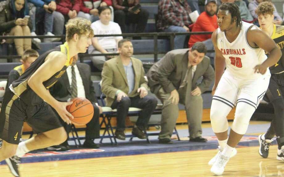 Big Rapids' DJ Greenbay (00) focuses on defense during the basketball season. (Pioneer photo file)