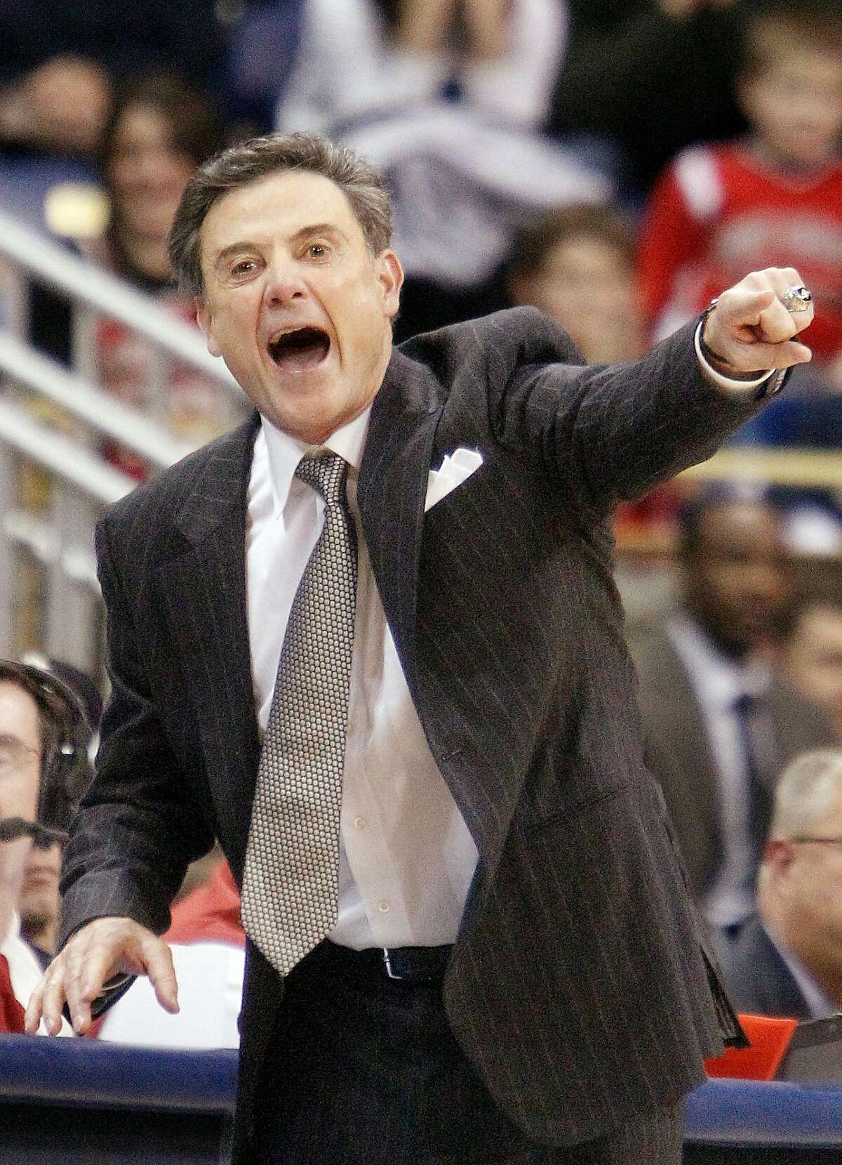 Louisville head coach Rick Pitino directs his team in the second half of the NCAA college basketball game against Pittsburgh on Saturday, Jan. 21, 2012, in Pittsburgh. Louisville won 73-62. (AP Photo/Keith Srakocic)