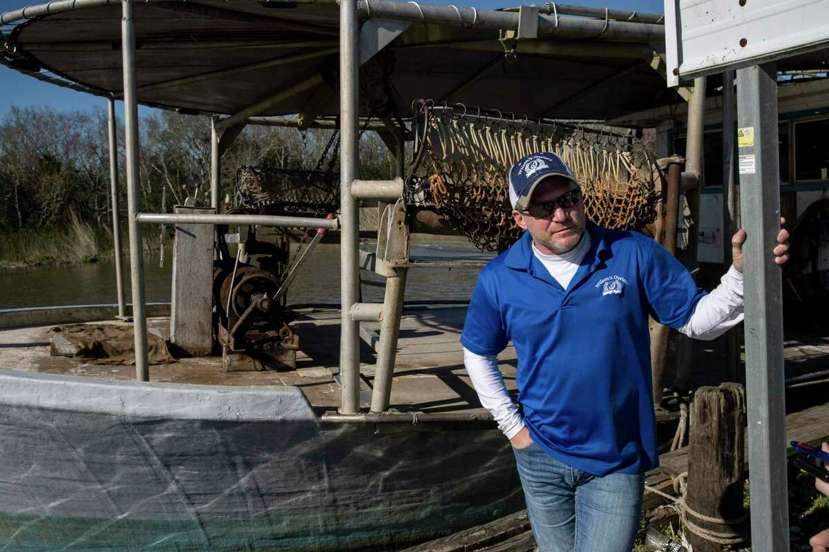 Toby Voisin, owner of Wilson's Oysters, stands at the company's dock Wednesday, Feb. 26, 2020, near Houma.