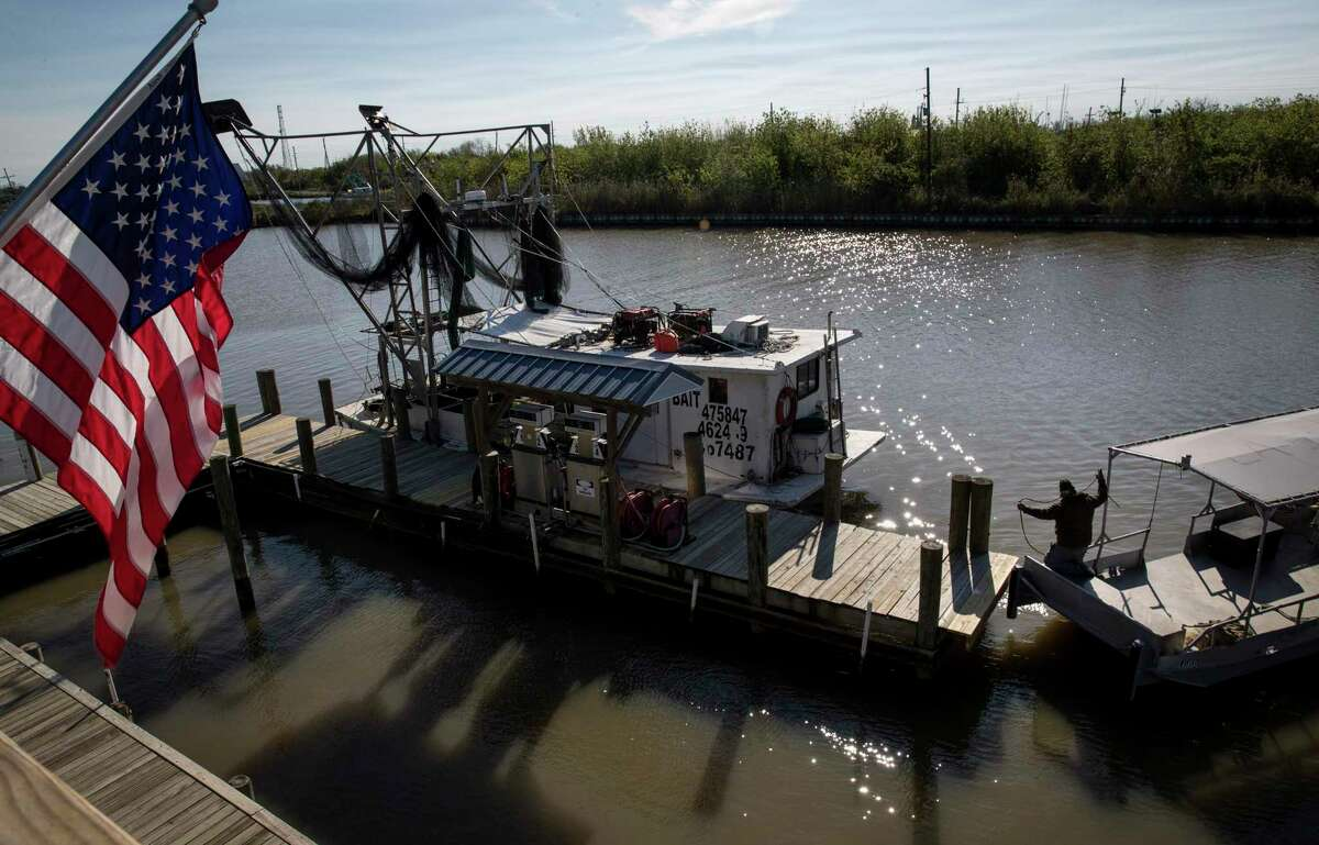 A fisherman prepares his boat Friday, Feb. 28, 2020, at the Delta Marina in Empire, La.