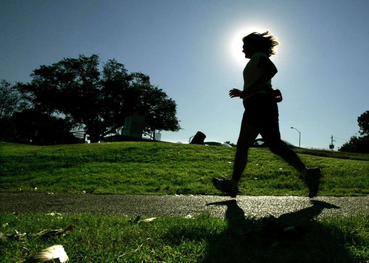 """Molly Graf, of Houston, runs along Allen Parkway as temperatures this weekend will allow people outside with out a sweat Friday, Oct. 12, 2007, in Houston. """"It's a delightful day,"""" Graf said. ( Johnny Hanson / For the Chronicle)"""