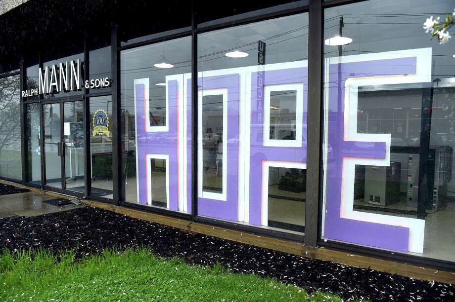 The word HOPE is displayed in the window of Ralph Mann & Sons in Ansonia during the stay at home period on April 13, 2020. Photo: Arnold Gold / Hearst Connecticut Media / New Haven Register