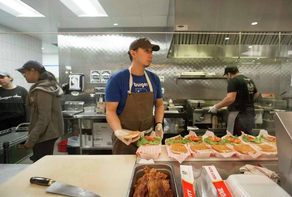 Burger-Chan Co-Owner and Chef Willet Feng works on an order Thursday, April 16, 2020, at Greenway Plaza in Houston.