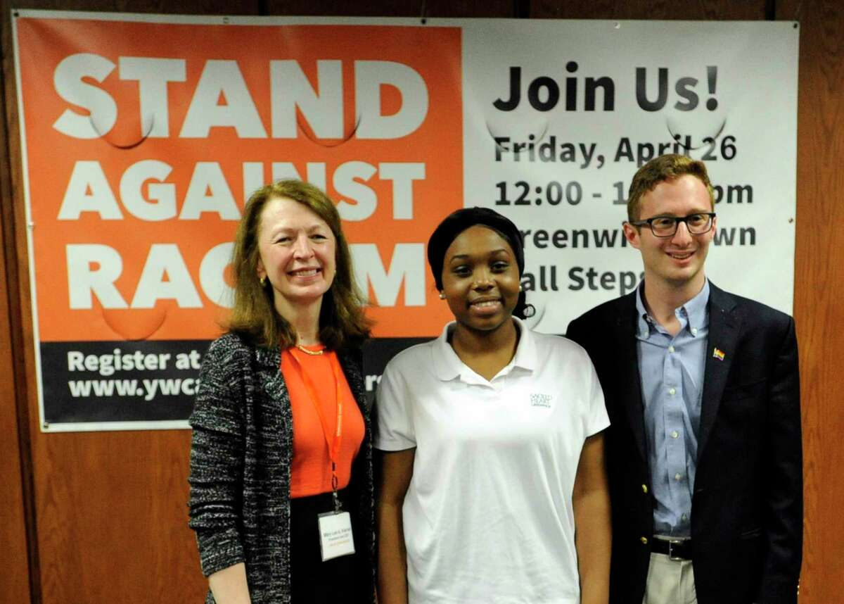 Racial Justice Scholarship Award recipients Sacred Heart Greenwich senior Ludnie Rene and Brunswick senior Charles Ciporin are photograph with Mary Lee Kiernan, President and CEO at YWCA Greenwich following a Stand Against Racism rally at Greenwich Town Hall in Greenwich, Conn. April 25, 2019.
