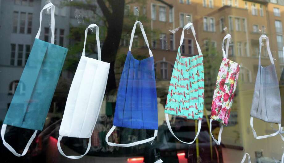 In this Thursday, April 16, 2020 photo face masks, that people can wear during the new coronavirus outbreak, are offered in a tailor shop in Berlin, Germany. The masks for mouth and nose are offerd for a price of 8 Euros each and made of 100% Cotton that can be washed by 60 degree celcius. Photo: Michael Sohn, AP / Copyright 2020 The Associated Press. All rights reserved