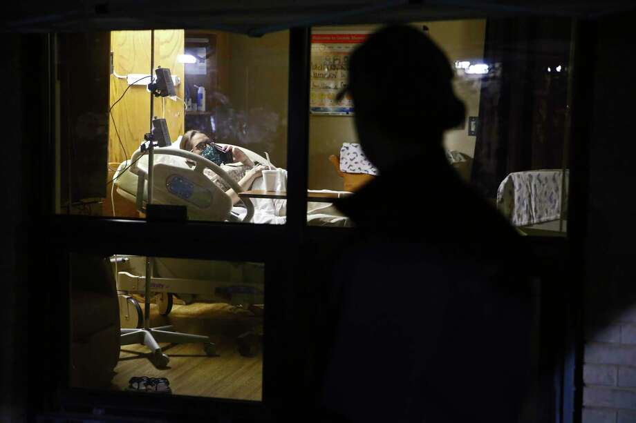After arriving at Uvalde Memorial Hospital around 3:20 a.m. on April 13, Alex Benavidez spent the morning watching Kayla labor through the hospital room window. They talked often by phone and video calls. Photo: Jerry Lara / **MANDATORY CREDIT FOR PHOTOG AND SAN ANTONIO EXPRESS-NEWS/NO SALES/MAGS OUT/TV   © 2019 San Antonio Express-News