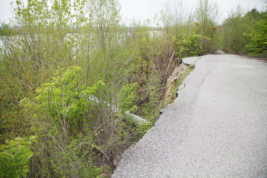 Since bluff erosion in 2010, part of the 900 block of Shelly Street in Alton where a portion of the roadway collapsed remains closed to vehicle traffic.